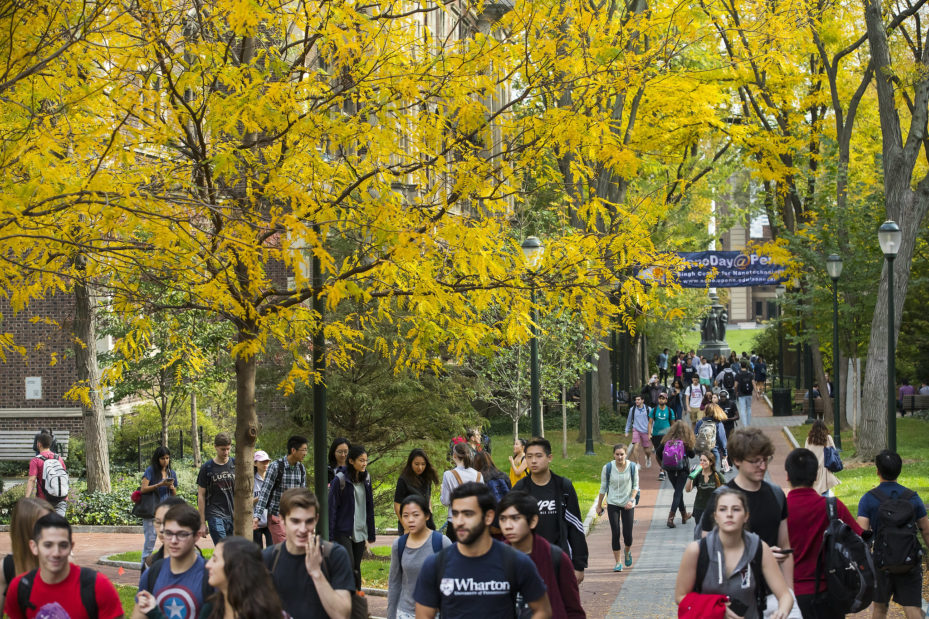 students in fall on locust walk.